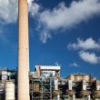 Industrial power plant with smokestack - ストック写真