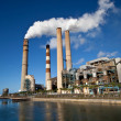 Stok fotoğraf: Industrial power plant with smokestack
