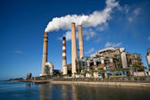 Industrial power plant with smokestack — Stok fotoğraf