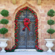 Christmas decoration on the old door - Stock Photo