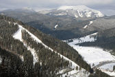 Tops of mountains Carpathians and valley in winter — Stock Photo