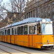 Orange tram in Budapest - Stock Photo