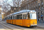 Orange tram in Budapest — Stockfoto