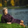 The woman on the bank of a pond — Stock Photo #8740445
