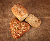 Bread over burlap — Stock Photo
