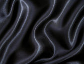 Slät elegant svart silke som bakgrund — Stockfoto