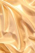 Smooth elegant golden silk as background — Foto de Stock