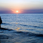 Pani w ciąży na zachód słońca — Zdjęcie stockowe