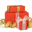 Holiday gift boxes decorated with bows and ribbons isolated on w — Stock Photo #7989164