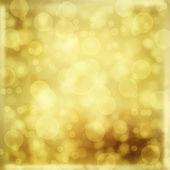 Oro telón de fondo para saludos o invitaciones con desenfoque bokeh — Foto de Stock