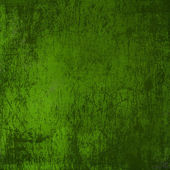 Grunge green background with ancient ornament — Stock Photo