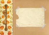 照片用的弓和彩绘的玫瑰的 grunge 黄金专辑 — 图库照片
