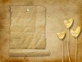 Vieux rouleau de papier accroché sur l'arrière-plan minable — Photo