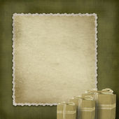 Vintage antigua postal de felicitación con regalos y el arco — Foto de Stock