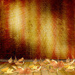 The fallen leaves on the background wall with vintage wallpaper — Stock Photo #9127789