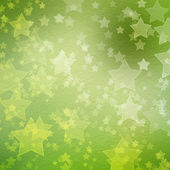 Green backdrop for greetings or invitations with stars — Stock Photo