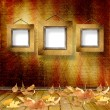 The fallen leaves on the background wall with vintage wallpaper — Stock Photo #9570644