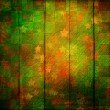 Photo: Grunge wooden vintage scratch background with blur boke.