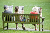 Newspaper readers — Stock Photo