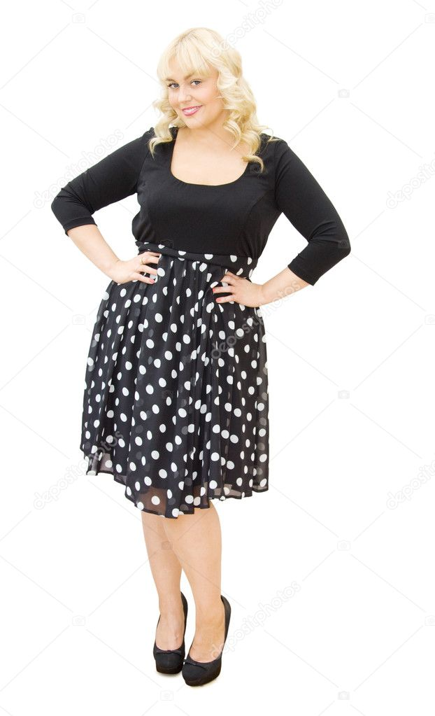 Getting ready to go party - beautiful woman dressed in lovely polka dots dress smiling. Isolated over white background. — Stock Photo #10556223