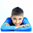 Laughing little boy laying on floor — Stock Photo