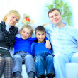 Portrait of a smiling family at home — Stock Photo #8454596