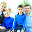 Portrait of a smiling family at home — Stock Photo