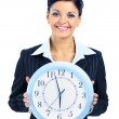 Happy woman in black with clock over white — Stock Photo