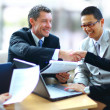 Business shaking hands, finishing up a meeting - 图库照片