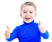 Portrait of a smiling cute little boy gesturing thumbs up sign against whit — Stock Photo