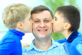 Little boys kiss to dad — Stock Photo