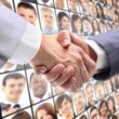 Handshake isolated on business background — Stockfoto