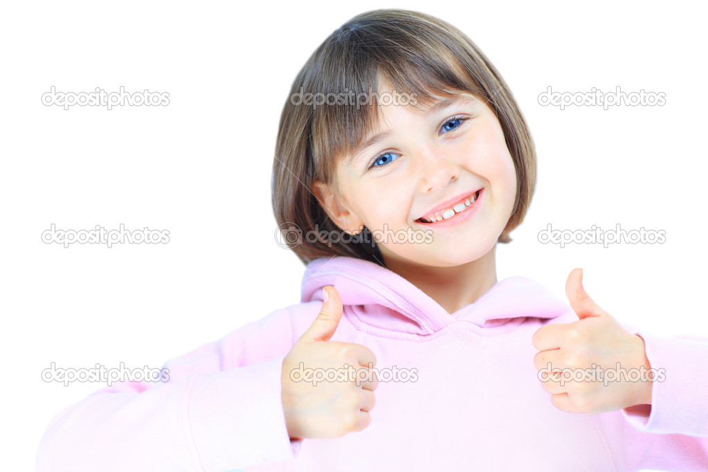 Young beautiful girl  child shows thumb up. Isolated on white background.  Stock Photo #8669503