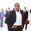 Business man on a background of many — Stock Photo