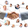 Stock Photo: Business handshake with company team in background