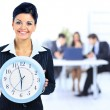 Young attractive business woman holding clock. — Stok fotoğraf