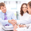 Royalty-Free Stock Photo: Happy business team talking together during a meeting sitting at
