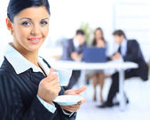 The business woman with a cup at office — Stock Photo