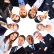 Group of business standing in huddle, smiling, low angle - Stock Photo