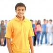 A young man with big group of the young smiling students. Over w — Stock Photo