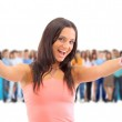 A young woman with big group of the young smiling students. Over — Stock Photo