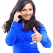 Royalty-Free Stock Photo: Smiling young female on the phone against a white background