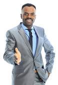 Přátelské afro-american podnikatel pozdrav s handshake — Stock fotografie