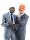 Portrait of confident worker discussing a project with his pretty colleague near by — Stock Photo