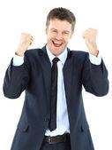 Ritratto di un successo godendo energico giovane imprenditore contro bianco - isolato — Foto Stock