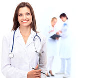 Female Doctor standing in Front of her team in the hospital — Stock Photo