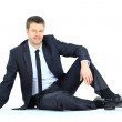 Portrait of business man sitting on the floor isolated over whit — Stock Photo #9625531