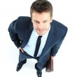 Portrait of a happy mature business man looking confident agains — Stock Photo