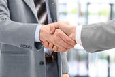 Business men in a handshake at the office — Stock Photo