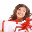 Excited attractive womwith many gift boxes and bags — Stock Photo #9870196